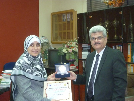 Honoring D / Abdel Nasser Hussein Riyad to Dr. /Heba Zaki  access to a doctorate degree